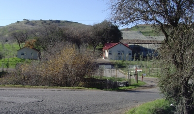 Cabral Ranch buildings. Carneros Vintners winery site above red roof.